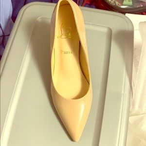 Nude Louboutin's shoes